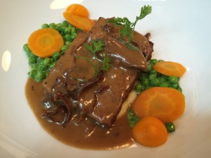 Meat loaf with peas, carrots and mushroom cream sauce