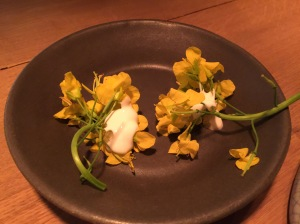 Rape blossoms with caviar and sour cream