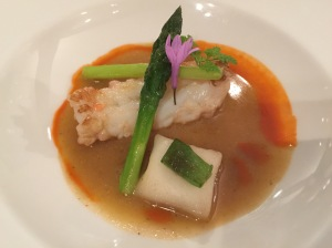 Roasted Norway lobster with ginger flavor, basil ravioli and green asparagus