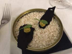 Something smoked on black rice cracker