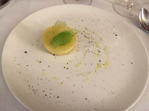 Lemon tart with goat cheese sorbet, olive oil, tea and sugar gremola