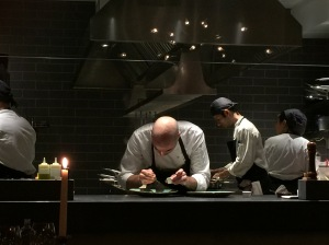 Chef looks over every plate before it is brought out