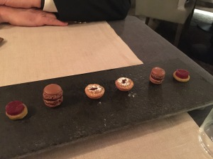 Little extras: warm pastry tarts and chocolate macaroons and raspberry on cake