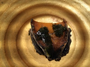 Abalone grilled over the embers, sauce of the liver and capers, grilled pork jowl. Topped with seaweed