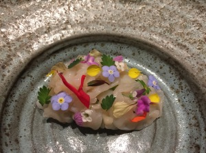 Geoduck with cucumber, salad burnett and spring flowers