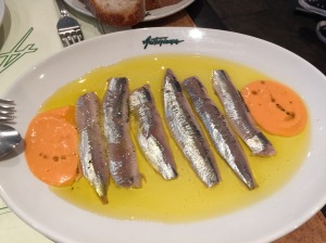 Cider marinated sardines with basil oil and tomato concasse