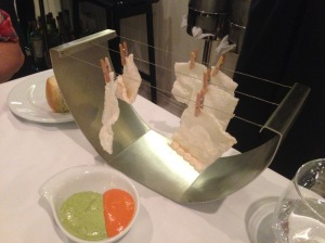 Dehydrated codfish (chips) with sweet red bell pepper couli and coriander aioli