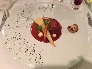 Lamb loin with pistachio, garlic puree and candied vegetables