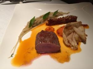 Crispy lamb belly with sea buckthorn, roast loin of Pogusch lamb, sweet potato, kohlrabiand sweet potato juice