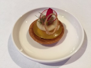 smoked eel in saffron jell in pastry with fried onion