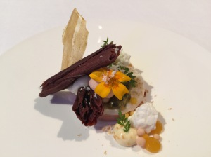 Duck liver with passion fruit, sheep's milk, bittersweet chocolate, peanut