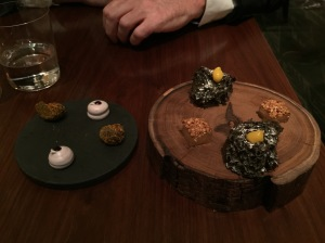 (far left) Pumpkin and whiskey, marshmallow macaroons, licorice cake, jelly with roasted nuts