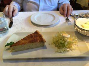 Classic Alsatian onion tart with a curly endive salad