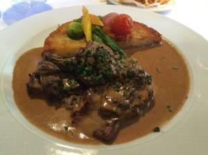 Veal medallions with a morel mushroom sauce and Swiss potato roesti