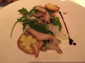 Roasted pine mushrooms with arugula and parmesan