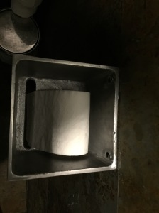 cool toilet paper holder in bathroom