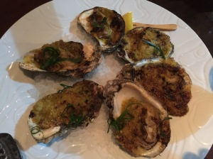 Fire roasted oysters with smoked Bienville butter
