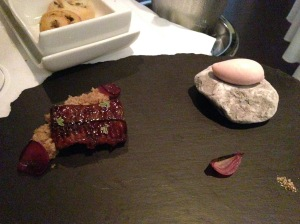 Smoked eel with teraki sauce and red onion. Cous cous, red wine and red onion sorbet on frozen rock