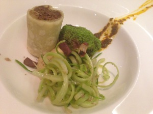 Variations of lamb with chicory and harissa sauce: stewed in a tortilla and chop with green crumbs