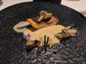 Roasted sea bass with artichokes, cockle, fishbone gravy aired with butter