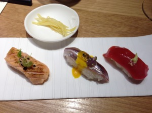 "The Nigiris: (R to L) Tuna nigiri with fresh wasabi; Anchovy nigiri with smoked ""aji Amarillo""; Salmon nigiri with aburi"