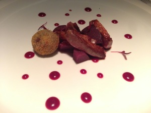 Araiz Squab with red wine poached pear, forest fruits and croqueta