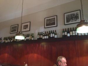 Wine bottles line the room
