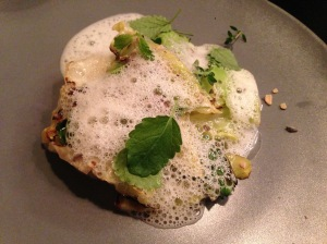 """Grilled cabbage, pumpkin seeds, pine herbs, foam sauce and """"hay cheese"""" (made from cows only fed hay)"""