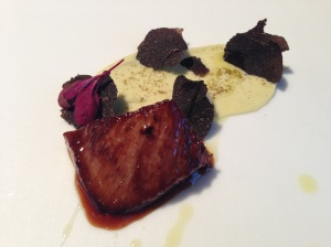 Glazed cheek with ginger and truffles with yello potato with black pudding and marrow.