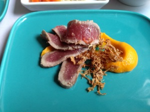 Seared fillet of lamb with carrot puree and dried cabbage