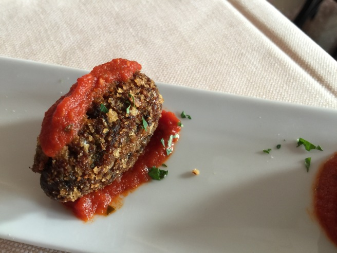 Eggplant croquettes in a spicy tomato sauce