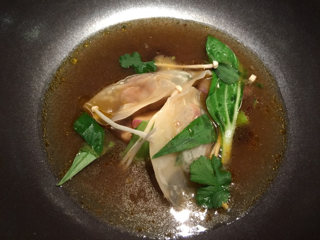Foie gras dumplings in duck broth with mushrooms and radish