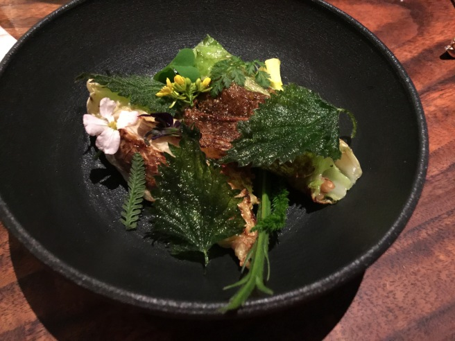Brassica leaves, blistered in the fire, broth of the cultured vegetables