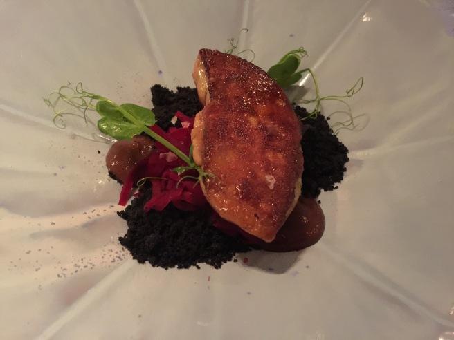 "Duck liver in ""black soil"", beetroot spaghetti, raisin cream"