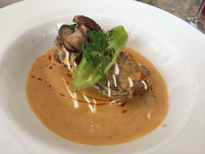 Goose breast with paprikash sauce and porcini mushrooms