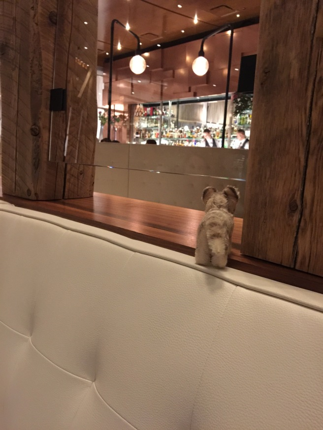 Frankie watched the bar in the back