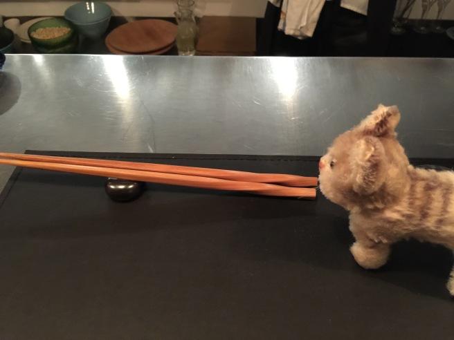 Frankie studied the chopsticks