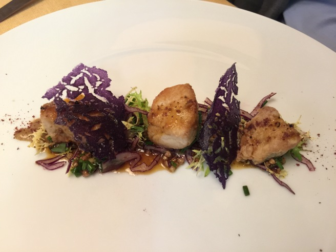 Roasted sweetbreads with black truffle sauce. Violet potatoes, red cabbage