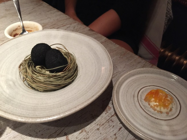 A small egg coated in ash, sauce made from dried trout and pickled marigold