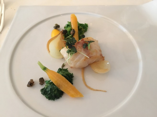 Monkfish with carrot, kale, capers and onion