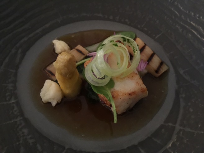Ling with asparagus, cauliflower and bok choy in chicken consommé