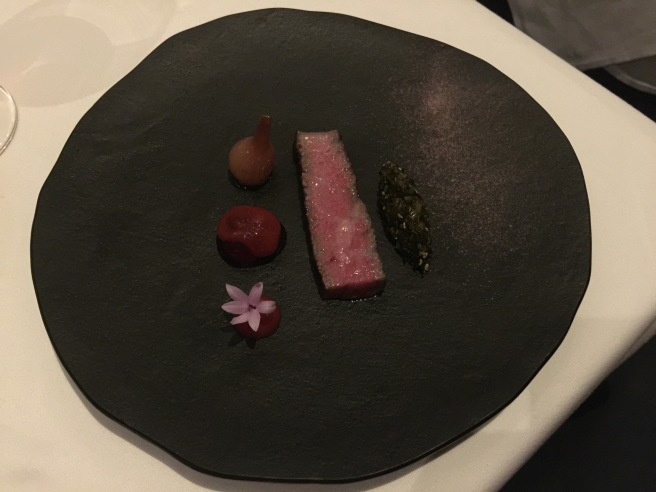 a5 wagyu with ebony rose pluot and spring onion