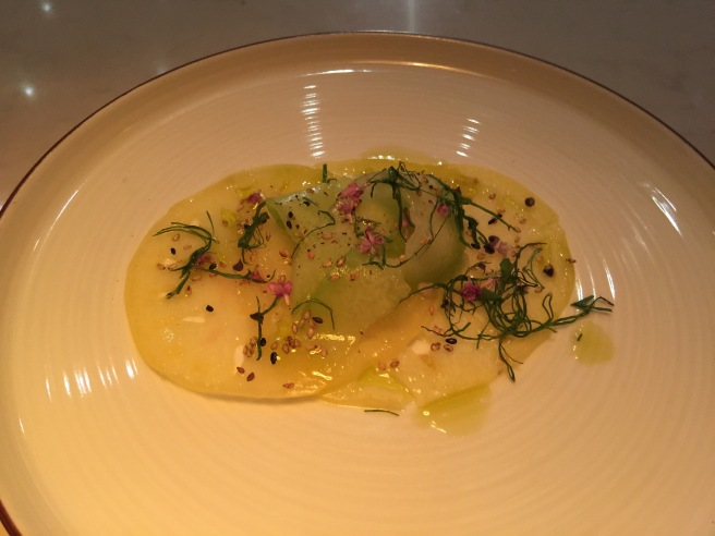 White wonder tomato carpaccio, sugar kiss melon, basid bud