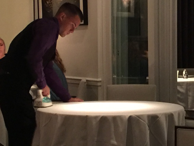 ironing the tablecloth on the table