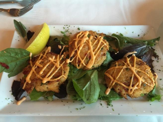 Maryland blue crab cakes, organic spring mix', sriracha mayo, $15