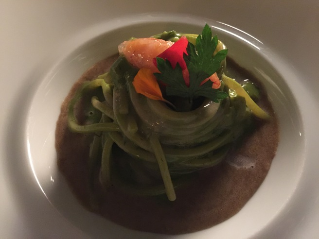 "Spaghetti with barley ""friselle"" sauce, artichokes and red prawns"