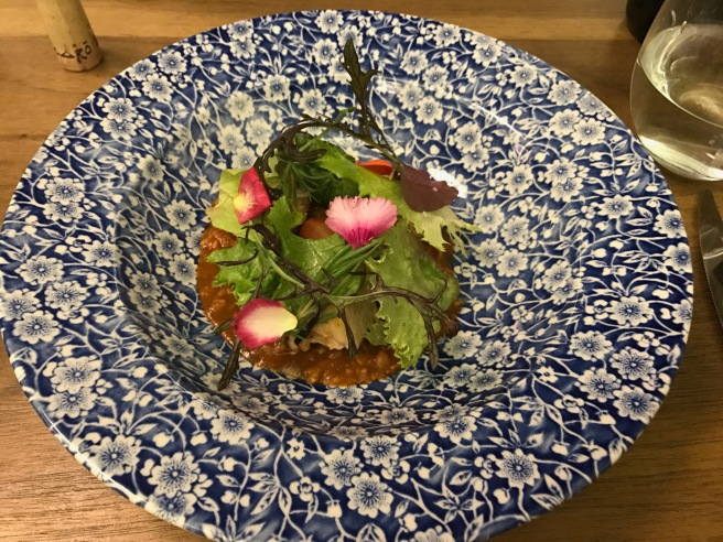 "Braised pork with blue corn ""cegueza"", winter lettuces and pickled ""rajas"""