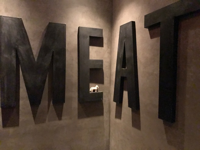 Frankie posed with the MEAT sign