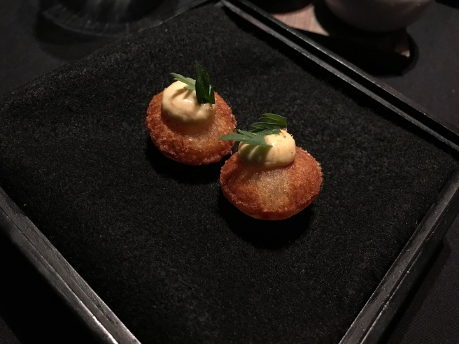 Pommes souffle with roe from winter flounder smoked in dried carrot tops