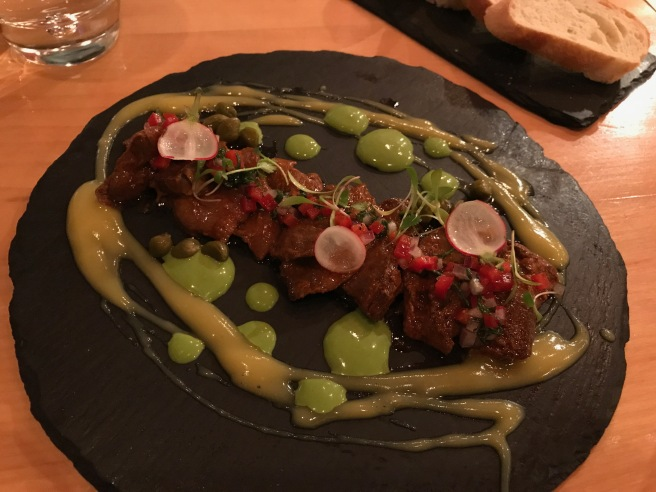 Corazón with salsa huacatay y chimichurri: beef heart with sauce